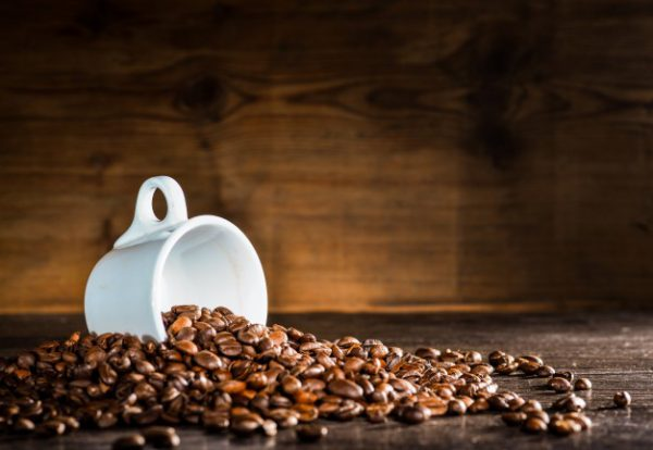 white-cup-surrounded-by-coffee-beans_1112-443